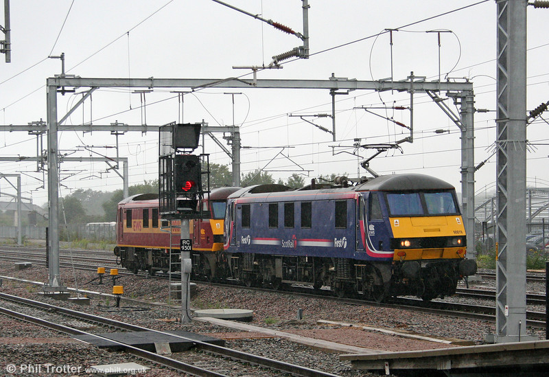 Scotrail liveried 90019 and 90018 head south through a rainy Rugby for Wembley on 5th August 2009.