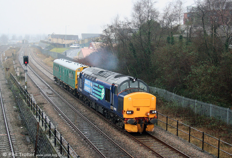 DRS 37423 heads Inspection Saloon 975025 'Caroline' through Swansea Loop East, forming 2Z27, 1334 Swansea to Cardiff (via Aberthaw) on 27th January 2007. The saloon would lead towards Cardiff, so the train was proceeding to turn on Landore triangle.