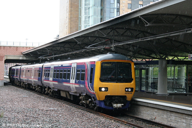 Northern 323238 arrives at the new platform 1 at Manchester Airport, working the 1633 Crewe to Manchester Piccadilly on 17th July 2009.