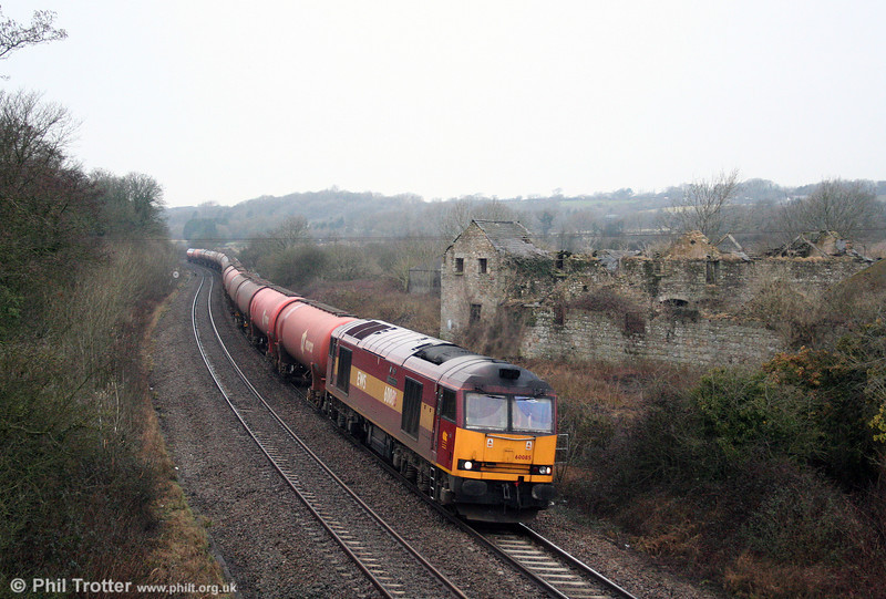 Now one of only 15 class 60s remaining in traffic, 60085 'Mini - Pride of Oxford' passes Llangewydd with 6B13, 0510 Robeston to Westerleigh loaded Murco tanks on 14th February 2009.
