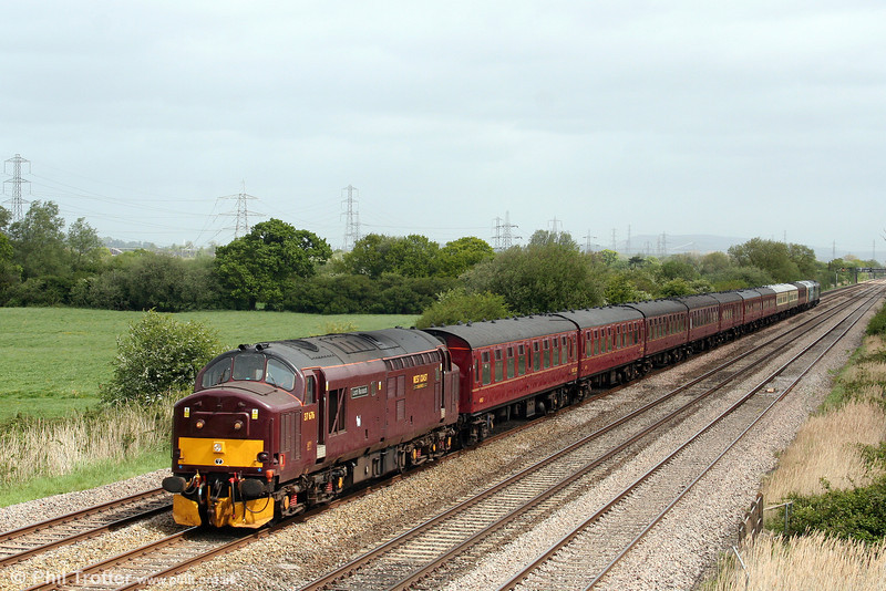 West Coast's 37676 'Loch Rannoch' passes Coedkernew with 5Z37, 0518 Carnforth to Bristol Temple Meads ECS on 8th May 2009. The train was routed via Cardiff in order to convey 50031 'Hood' to Canton for attention. Green 50044/D444 'Exeter' was at the rear. The stock was being taken to Bristol for the following day's 'Cambrian Mountaineer' railtour from Bristol to Aberystwyth.