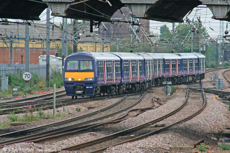 FCC has been taking delivery of class 321/4s from London Midland, displaced by the new class 350/2s. After refurbishment they are being used on the London to Peterborough corridor. 321404 approaches Peterborough forming the 1640 service from King's Cross on 4th August 2009.