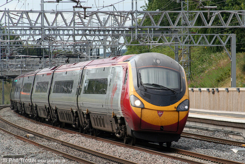 On 3rd August 2009, a 'Pendolino' tilts to the curve as it passes Tamworth bound for London Euston.