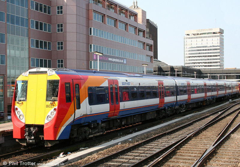 One of SWT's much maligned 'Juniper' units, 458027 waits to leave Reading forming the 1042 Reading to London Waterloo on 19th April 2010.