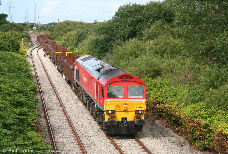 DB red (or if you prefer, 'Verkehrsrot' liveried) 59206 'John F Yeoman - Rail Pioneer' departs Trostre with 6B61, 1105 to Margam on 1st August 2010.