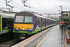 321415 at a wet and miserable Watford Junction forming the 1154 London Euston to Northampton on 20th March 2010.