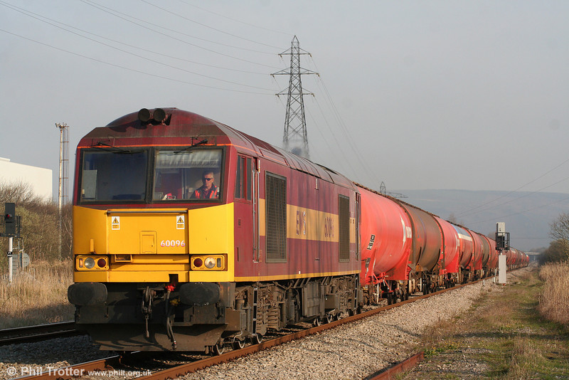 As you were. Following months of trialling class 66 and class 59 combinations, the Robeston to Westerleigh fuel trains have - for now at least - returned to class 60 haulage. 60096 passes Margam with 6B13, 0505 from Robeston on 15th April 2010.