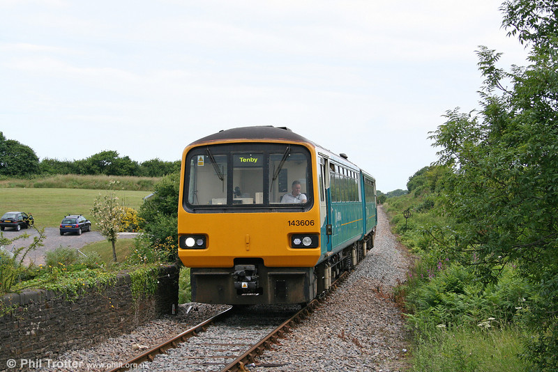 143606 approaches Kilgetty forming the 0940 Carmarthen to Tenby on 3rd July 2010.