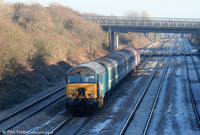57315 brings up the rear of 2C79, 1400 Cardiff Central to Taunton at Llandevenny on 4th January 2010.