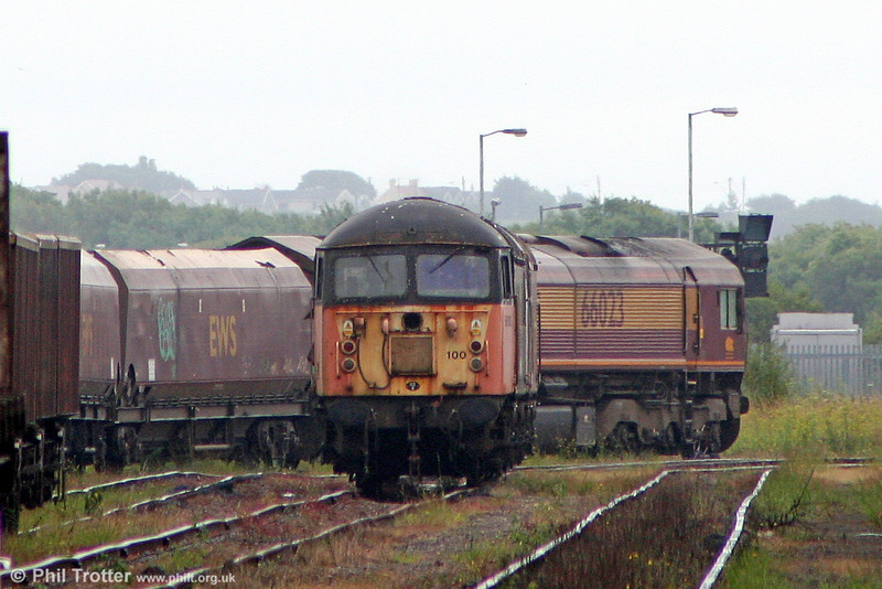 At Margam, long-stored 56100 (withdrawn December 2003) and 56062 (withdrawn February 2004) have been moved over to the eastern end of the Knuckle Yard pending disposal to EMR, Kingsbury for scrap. On 18th July 2010 Load Haul liveried 56100 is seen from a distance with 56062 tucked in behind as the pair await their final journey.