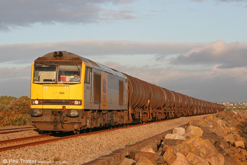 Making a brief return to South Wales, 60084 'Cross Fell' (nameplate on one side only) runs along the sea wall at Cefn Padrig Bay, Pwll with 6B07, 1800 Margam to Robeston on 15th September 2010.