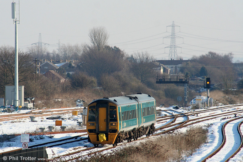 158818 approaches platform 1 at STJ forming the 1045 Cheltenham Spa to Maesteg on 8th January 2010. Note that the old crossover between the tunnel and the down Gloucester line is still in situ, although now not in use.