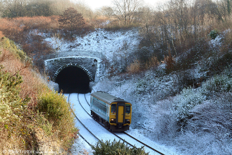 A wintry scene as ATW's 153323 emerges from Cockett Tunnel and passes through the site of Cockett Station (closed June 1964). The working is the 1205 Swansea to Pembroke Dock on 2nd January 2010.