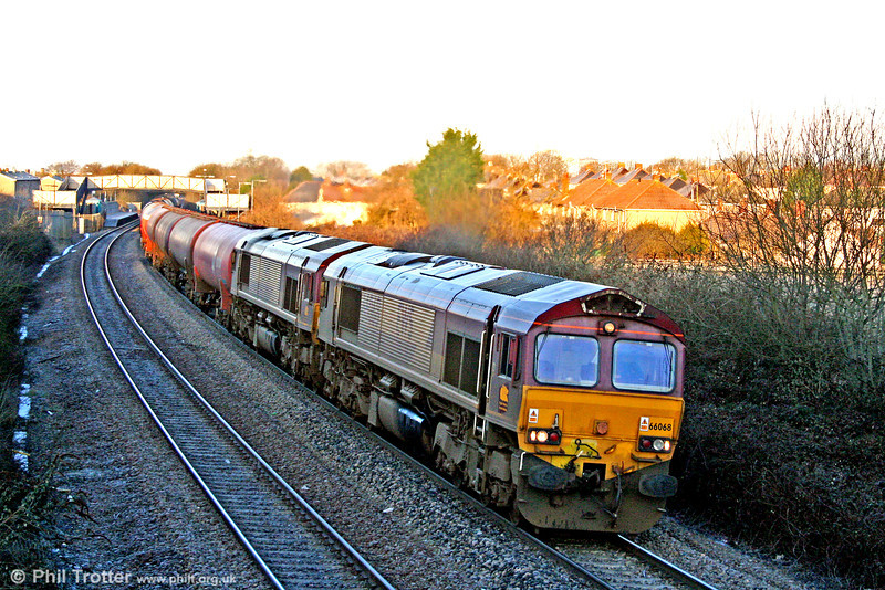 66068 and 66111 pass Pyle with 6B13, 0505 Robeston to Westerleigh on 30th January 2010