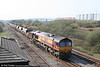 66207 brings up the rear of 6W03, Margam to Whitland autoballasters on 18th April 2010.