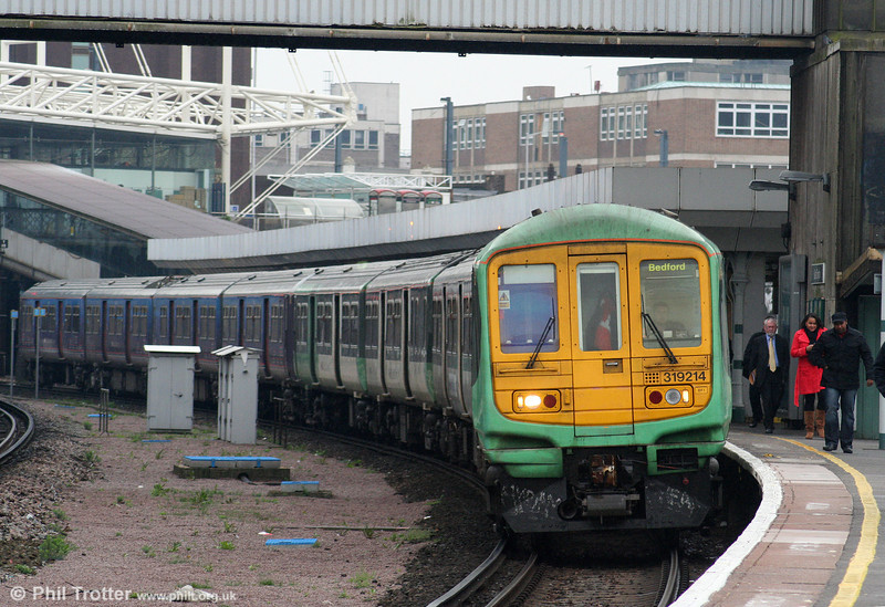 One of the class 319s rebuilt as class 319/2 in 1996-1997, 319214 is seen at East Croydon working FCCs 1137 Brighton to Bedford on 7th April 2010.