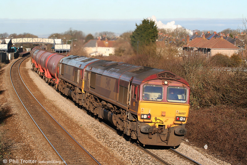 66007 and 66017 pass Pyle with 6B13, 0505 Robeston to Westerleigh on 6th March 2010.