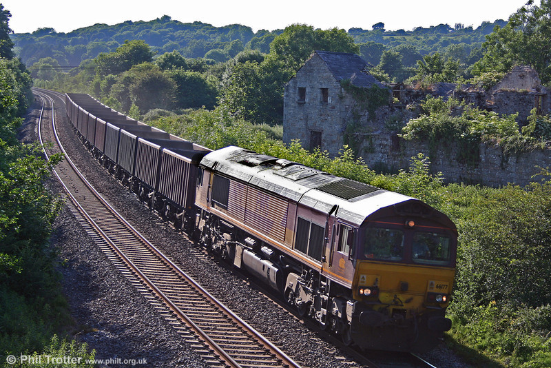Displaying its white cab roof, 66177 heads out of the sun at Llangewydd with 6E20, 1835 Margam to Immingham on 22nd June 2010.