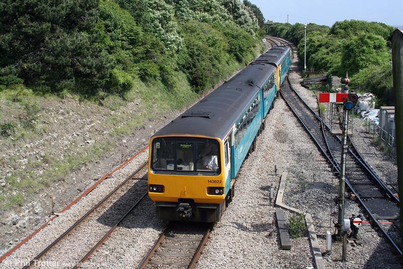 143622 leads a class 142 through Aberthaw forming the 1338 Merthyr Tydfil to Bridgend on 13th June 2010.