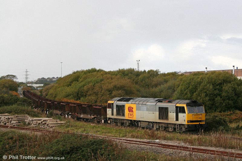 60063 'James Murray' departs from Trostre with 6B16, 1536 Trostre to Margam empties on 23rd October 2010.