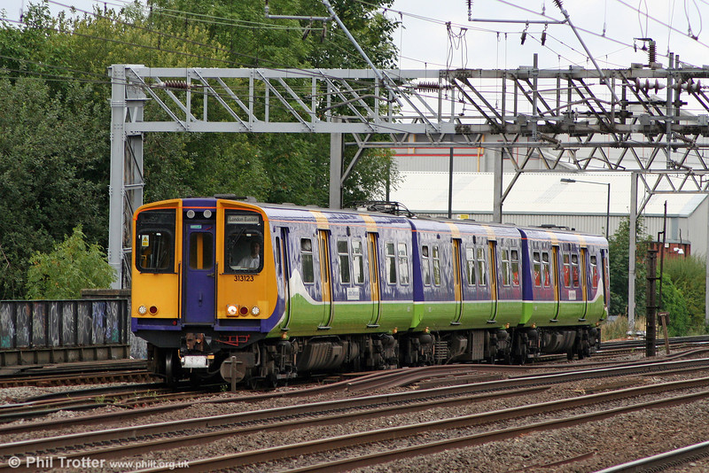 Very few class 313s now remain in service with LOROL. 313123 approaches Harrow & Wealdstone forming the 1101 Watford Junction to London Euston on 7th August 2010.