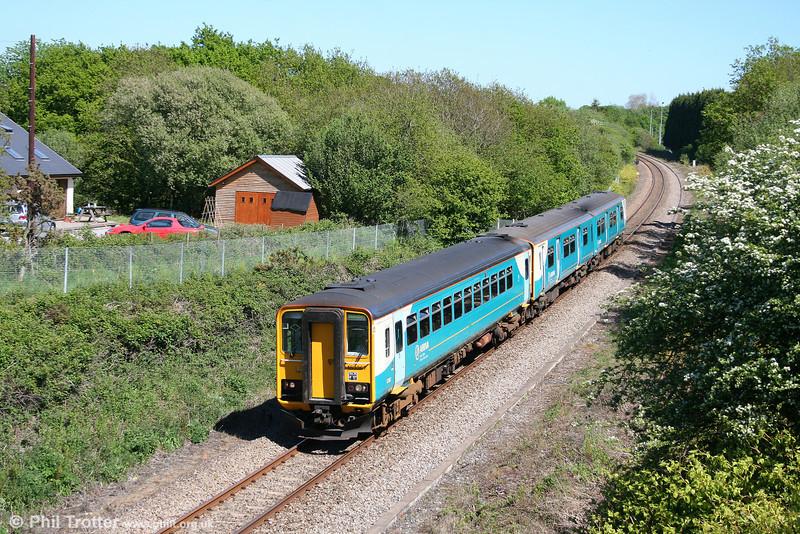 153367 leads the 1504 Swansea to Shrewsbury through Waunarlwydd on 23rd May 2010.