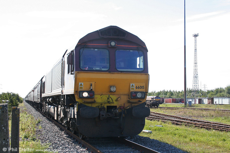 66015 waits to leave Margam, Knuckle Yard with 1Z50, 0650 Crewe to Robeston, 'The Western Wales Explorer' on 18th September 2010.