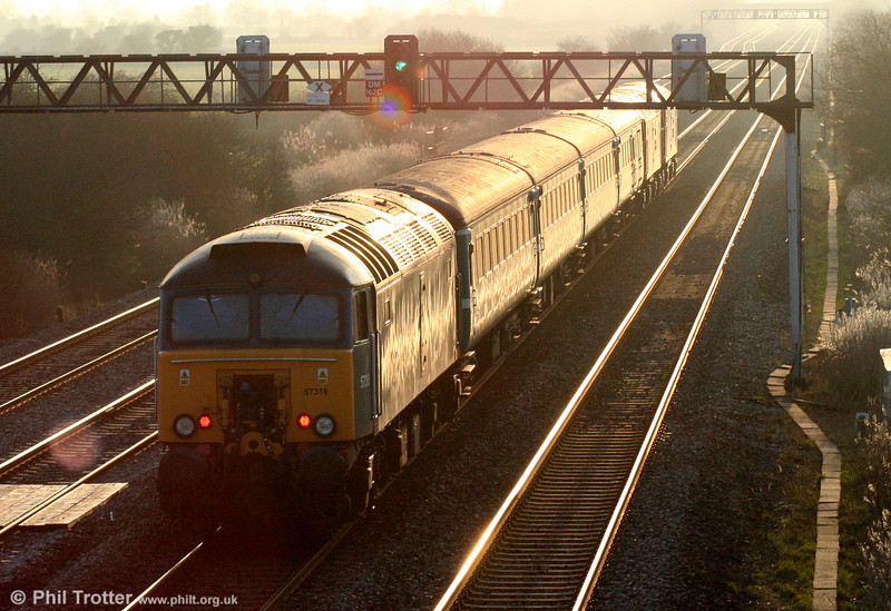 Into the sunset... 57316 at the rear of 5U89, 1402 Taunton to Cardiff Canton ECS at Coedkernew on 6th February 2010.