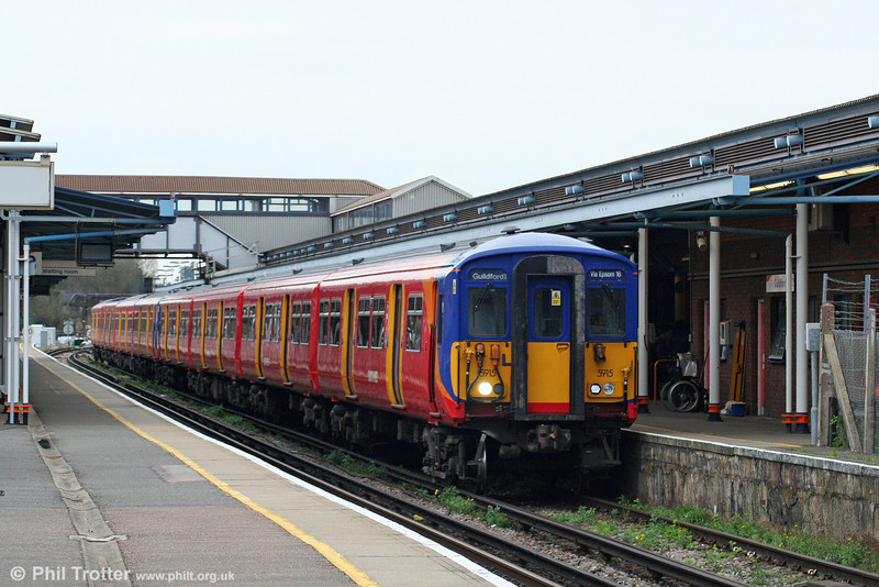 The 1339 from London Waterloo in the form of 455915 arrives at Guildford on 7th April 2010.