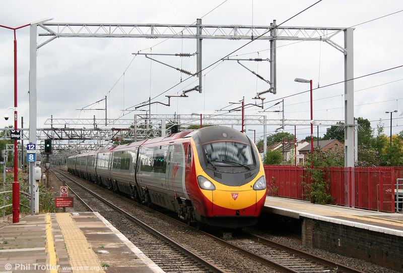 On the final leg of its journey to London Euston, a VWC Pendolino is seen at Harrow & Wealdstone on 7th August 2010.