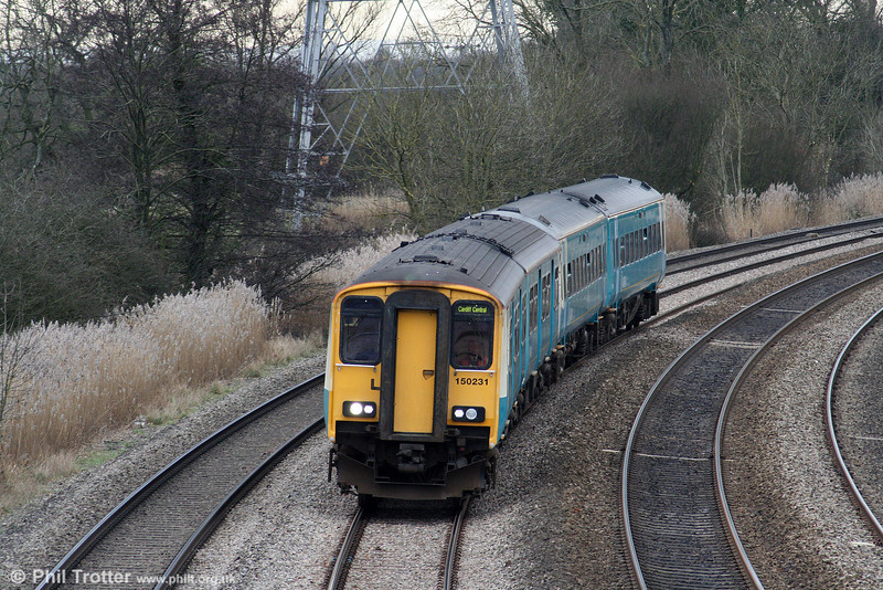 150231 leads 158821 through Duffryn with a Cardiff Central to Newport rugby shuttle service on 13th February 2010.