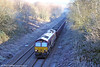 66166 passes Llangyfelach with 6G05, 0920 Swansea Burrows to Gwaun-Cae-Gurwen on 14th December 2010.
