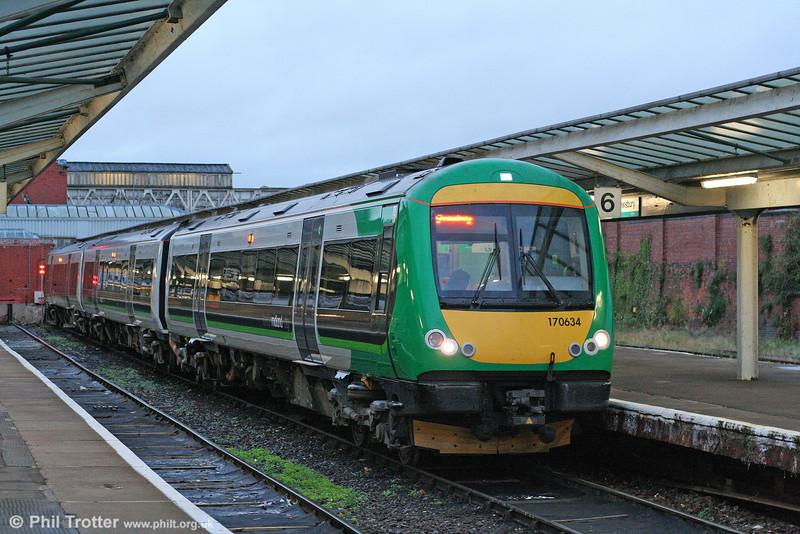 London Midland 170634 waits to leave Shrewsbury forming the 1647 service to Birmingham New Street on 3rd November 2010.