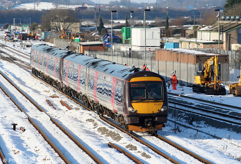 170523 and 170518 at a snowy STJ forming the 1045 Cardiff Central to Nottingham on 8th January 2010.