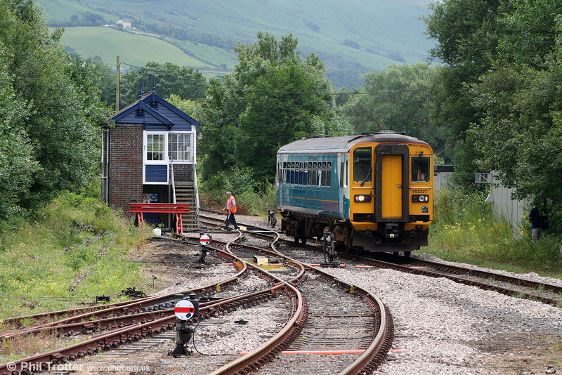 The Pantyffynnon signalman returns to the 'box having handed the token to the driver of 153327 forming the 1316 Swansea to Shrewsbury on 10th July 2010.