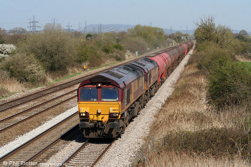 66035 and 66061 pass Coedkernew with an early running 6B33, 1212 Theale to Margam on 17th April 2010.