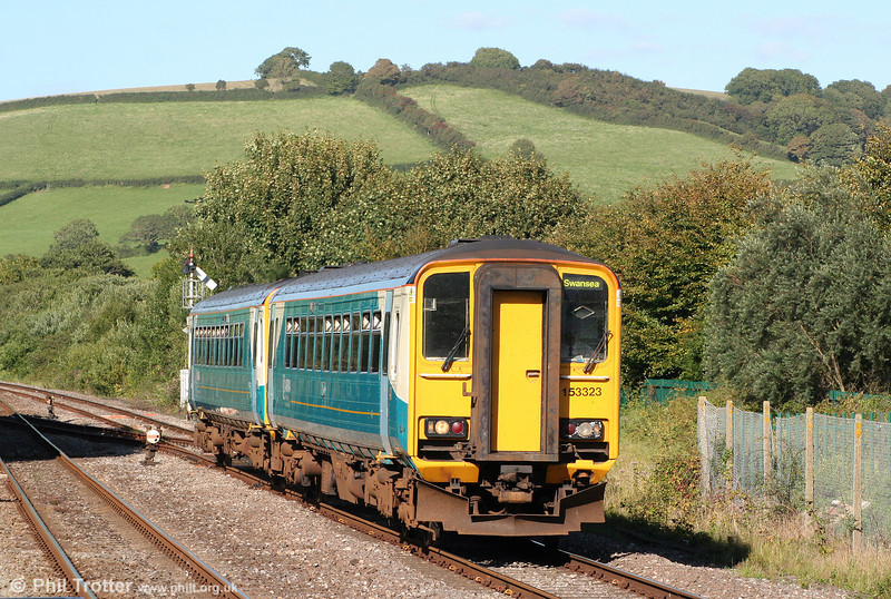 153323 and 153303 approach Ferryside forming a strengthened bank holiday 1455 Pembroke Dock to Swansea on 30th August 2010.