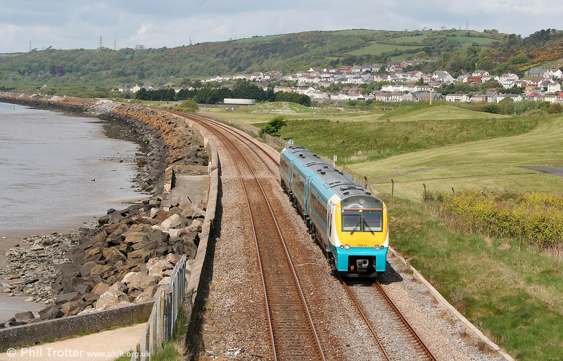 175113 is seen at Pwll forming the 1101 Carmarthen to Manchester Piccadilly on 15th May 2010.