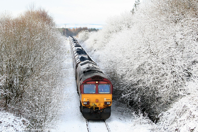 A wintry scene as 66094 approaches Hirwaun with 6C45, 1054 Tower Colliery to Aberthaw Power Station on 27th November 2010.