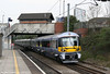 A largely empty HE 332014 passes Acton Main Line with the 1525 London Paddington to Heathrow Airport on 19th April 2010.