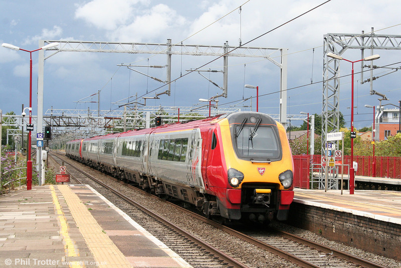 A storm threatens as VWC 221107 'Sir Martin Frobisher' leads a double set through Harrow & Wealdstone for London Euston on 7th August 2010.
