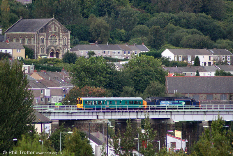DRS 37423 'Spirit of the Lakes' crosses Landore Viaduct on the approach to Swansea, propelling Inspection Saloon 975025 'Caroline' and running as 2Z01, 0931 Ealing Broadway to Swansea on 21st September 2010.