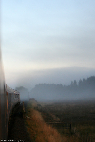 Season of mists and mellow fruitfulness: 67030 heads 1S25, 2115 'The Caledonian Sleeper' from London Euston near Aviemore on 12th October 2010.