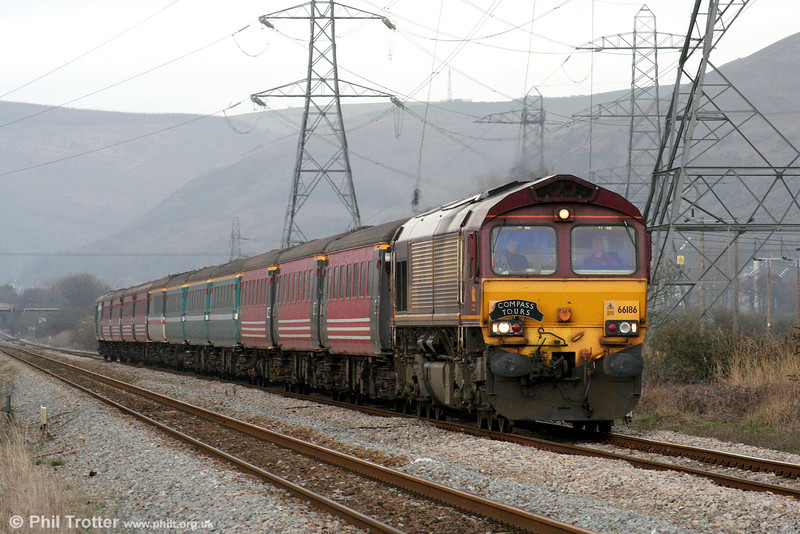 66186 passes Margam with Compass Tours 1Z90, 0542 Preston To Cardiff Central 'The Heart of Wales Moorlander' on 27th March 2010.