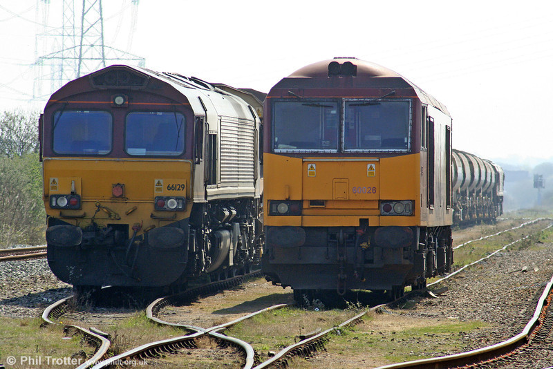 60026 alongside 66129 on autoballasters at Margam Knuckle Yard on 18th April 2010.