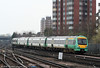 171804 approaches East Croydon forming the 1208 London Bridge to Uckfield service on 7th April 2010. 171s are not compatible with class 170s used elsewhere due to being fitted with Dellner couplers.