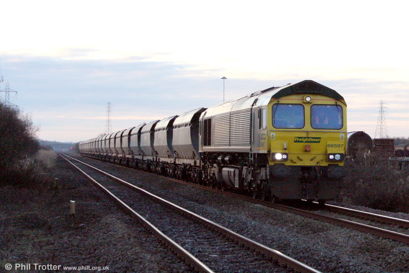 66597 passes Margam with 6B42, 0706 Stoke Gifford to Neath Abbey Wharf on 15th December 2010.