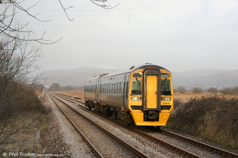158836 approaches Llangennech forming the diverted 1238 Hereford to Milford Haven on 17th January 2010.