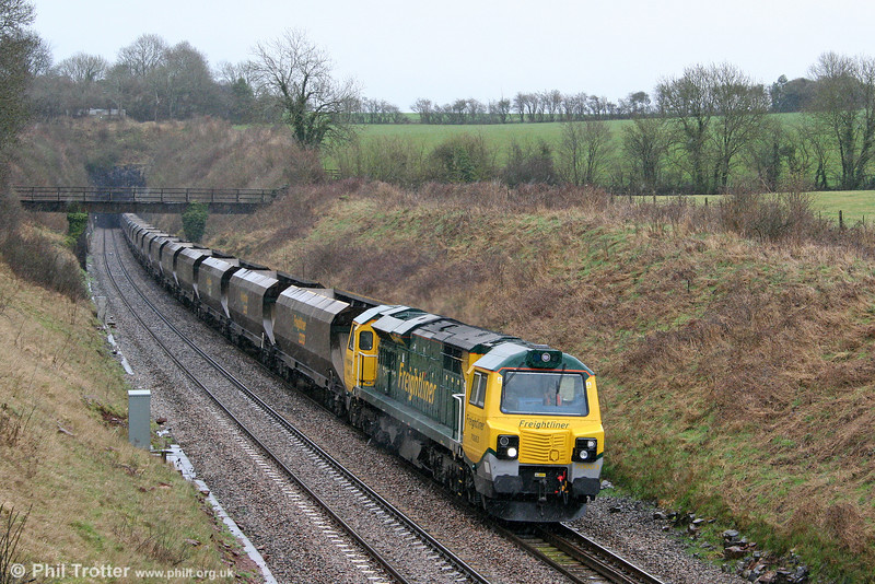 70003 passes wet and windy Wickwar with 4Z70, 0853 Rugeley Power Station to Stoke Gifford coal empties on 2nd April 2010.