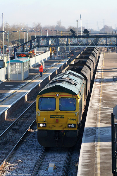 Having emerged from the Severn Tunnel, down freights now wait in the platform before getting the road towards Newport. 66596 waits with 6M04, 1030 Avonmouth to Rugeley Power Station on 4th January 2010.